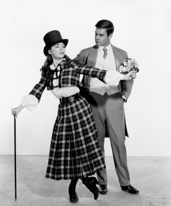 "The 1958 Academy Award®-winning film ""Gigi,"" won nine Academy Awards®, triumphing in every category for which it was nominated. The film's stars Leslie Caron (left) and Louis Jourdan (right) are shown here in a publicity still. Restored by Nick & jane for Dr. Macro's High Quality Movie Scans Website: http:www.doctormacro.com. Enjoy!"