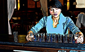 Brunette hostess aligning shot glasses on the bar
